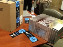 Image of Amazon boxes on a table with bookmarks visible